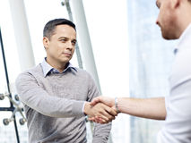Businessman shaking hands with competitor Royalty Free Stock Photography