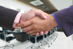 Businessman shaking hands Stock Photos