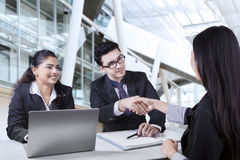 Businessman shaking hands with new worker Royalty Free Stock Image