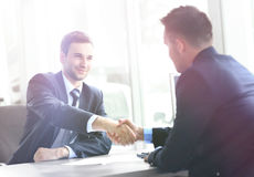 Businessman shaking hands in office Stock Images
