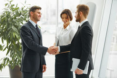 Businessman shaking hands. People shake hands communicating with Stock Image