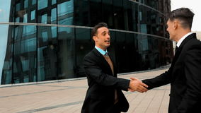 Businessman shaking hands stock video
