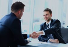 Businessman shaking hands to seal a deal with his partner. Stock Image