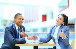 Businessman shaking hands to seal Stock Photography