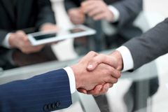 Business men shaking hands. Closeup. Businessman shaking hands to seal a deal with his partner royalty free stock image
