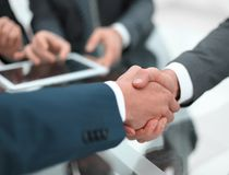 Business men shaking hands. Closeup. Businessman shaking hands to seal a deal with his partner stock images