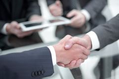 Business men shaking hands. Closeup. Businessman shaking hands to seal a deal with his partner royalty free stock images
