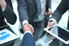 Business men shaking hands. Closeup. Businessman shaking hands to seal a deal with his partner royalty free stock photos