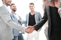 Businesspeople shaking hands in board room royalty free stock images