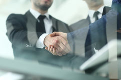 Businessman shaking hands to seal a deal with his partner Royalty Free Stock Photo