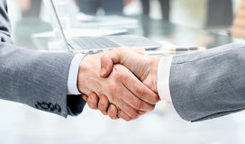 Businessman shaking hands to seal a deal with his partner Royalty Free Stock Image