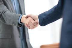 Businessman shaking hands to seal a deal with his partner Royalty Free Stock Photos