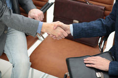 Businessman shaking hands to seal a deal with his partner Stock Photo
