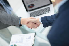Businessman shaking hands to seal a deal with his partner Stock Photos