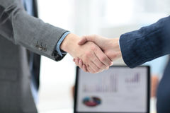Businessman shaking hands to seal a deal with his partner Stock Images