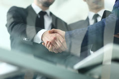 Businessman shaking hands to seal a deal with his partner Stock Image