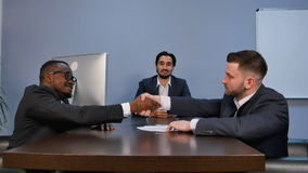 Businessman shaking hands to seal a deal with his partner during meeting stock image