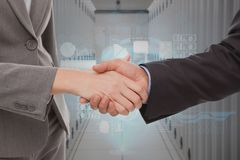 Businessman shaking their hands in a data center royalty free stock photography