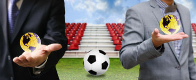 Businessman share football game to the world Stock Image