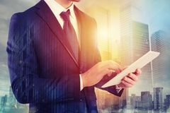 Businessman shares document with tablet. Internet concept Royalty Free Stock Photos