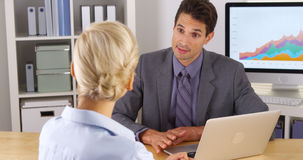 Businessman sharing his research with colleague in the office royalty free stock photography