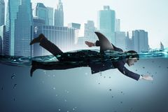 The businessman with shark fin swimming in water. Businessman with shark fin swimming in water royalty free stock photo
