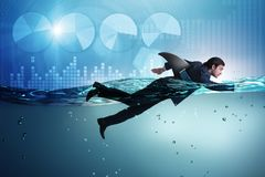 The businessman with shark fin swimming in water. Businessman with shark fin swimming in water royalty free stock photos