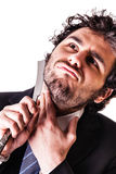 Businessman shaving with razor Stock Photo