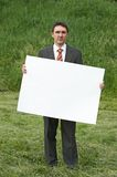 Businessman and sheet of paper Stock Photo