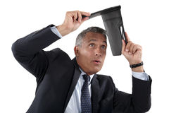 Businessman shielding himself Royalty Free Stock Photo
