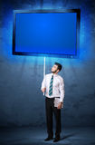 Businessman with shining tablet Stock Photo