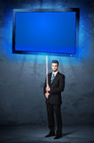 Businessman with shining tablet Stock Photography