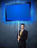 Businessman with shining tablet Stock Image
