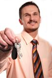 Businessman in the shirt with keys stock photography
