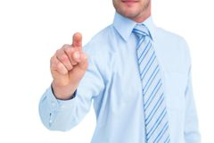 Businessman in shirt pointing with his finger Royalty Free Stock Image