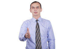 Businessman in a shirt and a tie stretches out his hand for a handshake. Stock Photography