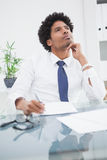 Businessman in shirt writing and thinking Stock Photography