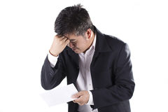 Businessman Shocked received layoff notice. Isolated on white background Stock Photography