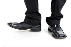 Businessman shoes. Businessman black and shiny shoes Royalty Free Stock Image