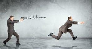 Businessman shooting  another man Royalty Free Stock Photos