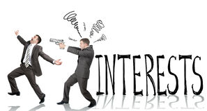 Businessman shooting  another man. With word interests isolated on white background Stock Images