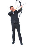 Businessman shooting a bow and arrow Stock Image
