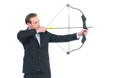 Businessman shooting a bow and arrow Stock Photo
