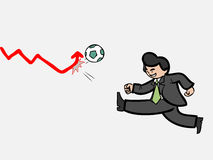 Businessman shooting football to push graph Royalty Free Stock Photos