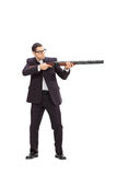 Businessman shooting with a rifle Royalty Free Stock Images