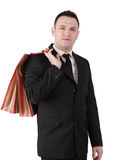 Businessman with shopping bag. Image of a young businessman with a shopping bag isolated against a white background Stock Image
