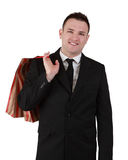 Businessman with shopping bag. Image of a smiling young businessman with a shopping bag isolated against a white background Royalty Free Stock Photography