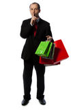 Businessman with shopping bags Stock Photography