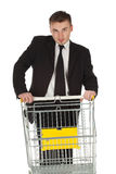 Businessman and shopping cart Royalty Free Stock Photography
