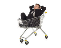 Businessman in shopping cart Stock Photos